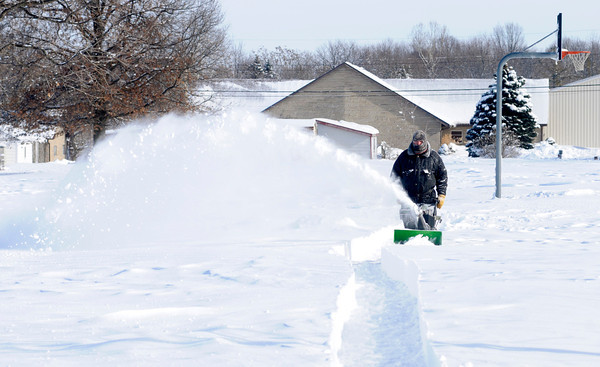 Don Knight / The Herald Bulletin<br /> Rob Sayre uses a snow blower to clear the paths around Alexandria-Monroe Intermediate School on Tuesday. Alexandria Community Schools have been closed since Sunday's snow storm.