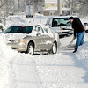 THB photo/John P. Cleary<br /> An Anderson city truck gives this motorist a tug to get him out of the snow bank on west 25th Street.