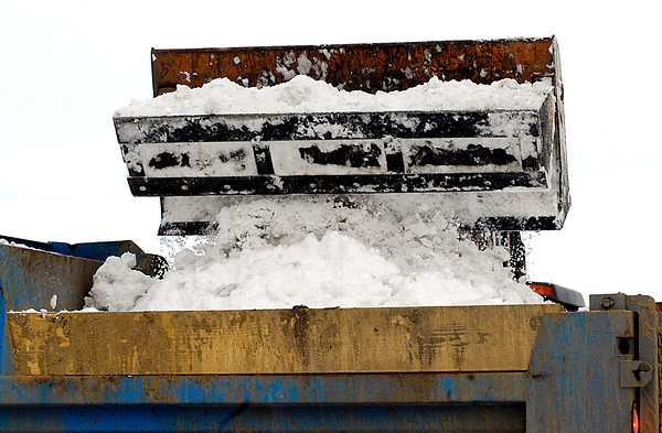 THB photo/John P. Cleary<br /> Anderson city workers were scooping up buckets of snow and hauling it away by the truck full out of the downtown area Wednesday morning.