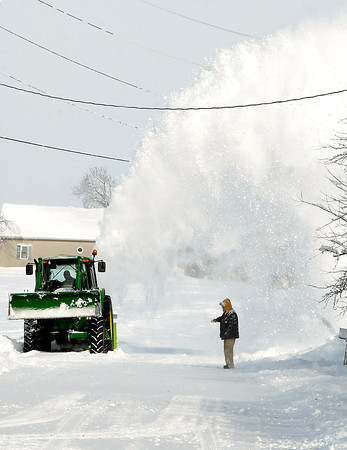 THB photo/John P. Cleary<br /> This person uses a large snow blower attached to a tractor to effectively  throw the snow off North Pendleton Ave. north of CR 600 South Monday afternoon.