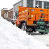 THB photo/John P. Cleary<br /> As the temperatures started to rise Wednesday Anderson Street Department trucks were out spreading salt to help with the melting process.  Here one was salting along Meridian Street downtown passing a large pile of plowed snow.