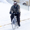 Don Knight / The Herald Bulletin<br /> A bicyclist travels north on Harrison Street on Tuesday. After two days of frigid temperatures warmer weather is forecast for the rest of the week.