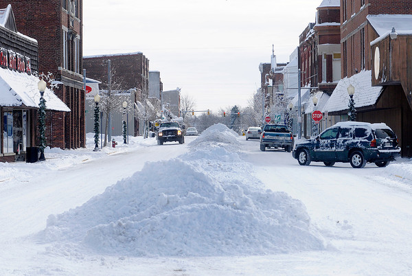 Don Knight / The Herald Bulletin<br /> Snow sits in piles in the middle of Harrison St. on Tuesday following Sunday's snow storm.