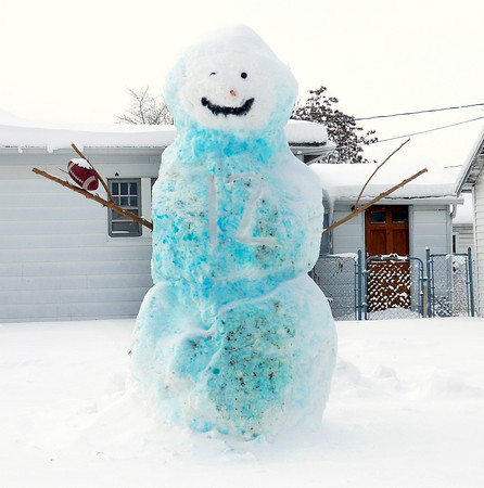 Don Knight / The Herald Bulletin<br /> A snowman tinted blue with food coloring, wearing Andrew Luck's number on his chest and holding a football stands at the intersection of 3rd and Locust in Anderson.