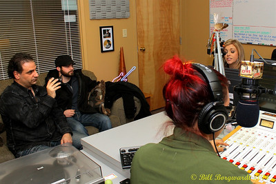 Anthony Farrauto videos the interview while road manager, Gavin Crane, watches Lindsay Ell in CFWE studios