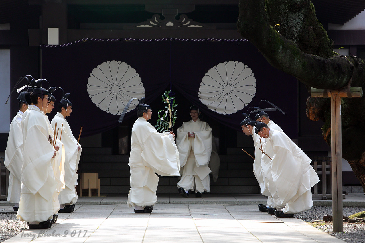 "Shinto priests prepare to walk to Torii gate before they administer a Shinto rite ""Kiyoharai"""