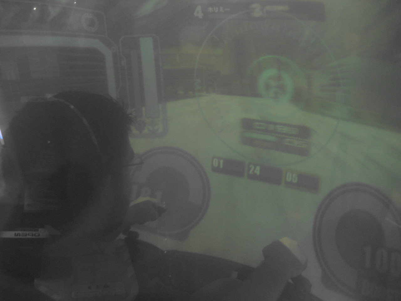 A view through the tinted shell as Josh manipulates this tank.