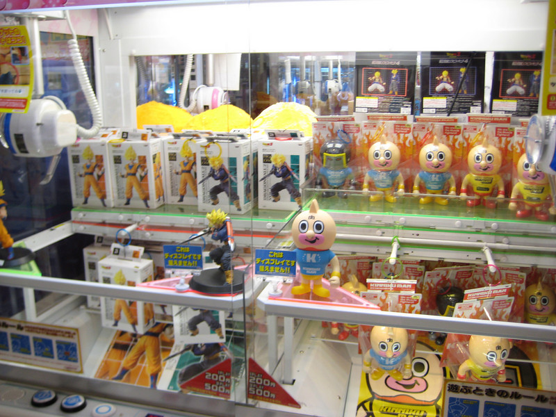 The crane games are interesting. On this one, there are prizes hanging by a ring on a peg. All you have to do is move the crane from one side to the other until it is lined up with one of the prize rings. If you're on target, the crane will hook the ring and pull the prize off the peg. It looks easy.<br /> <br /> It's not.