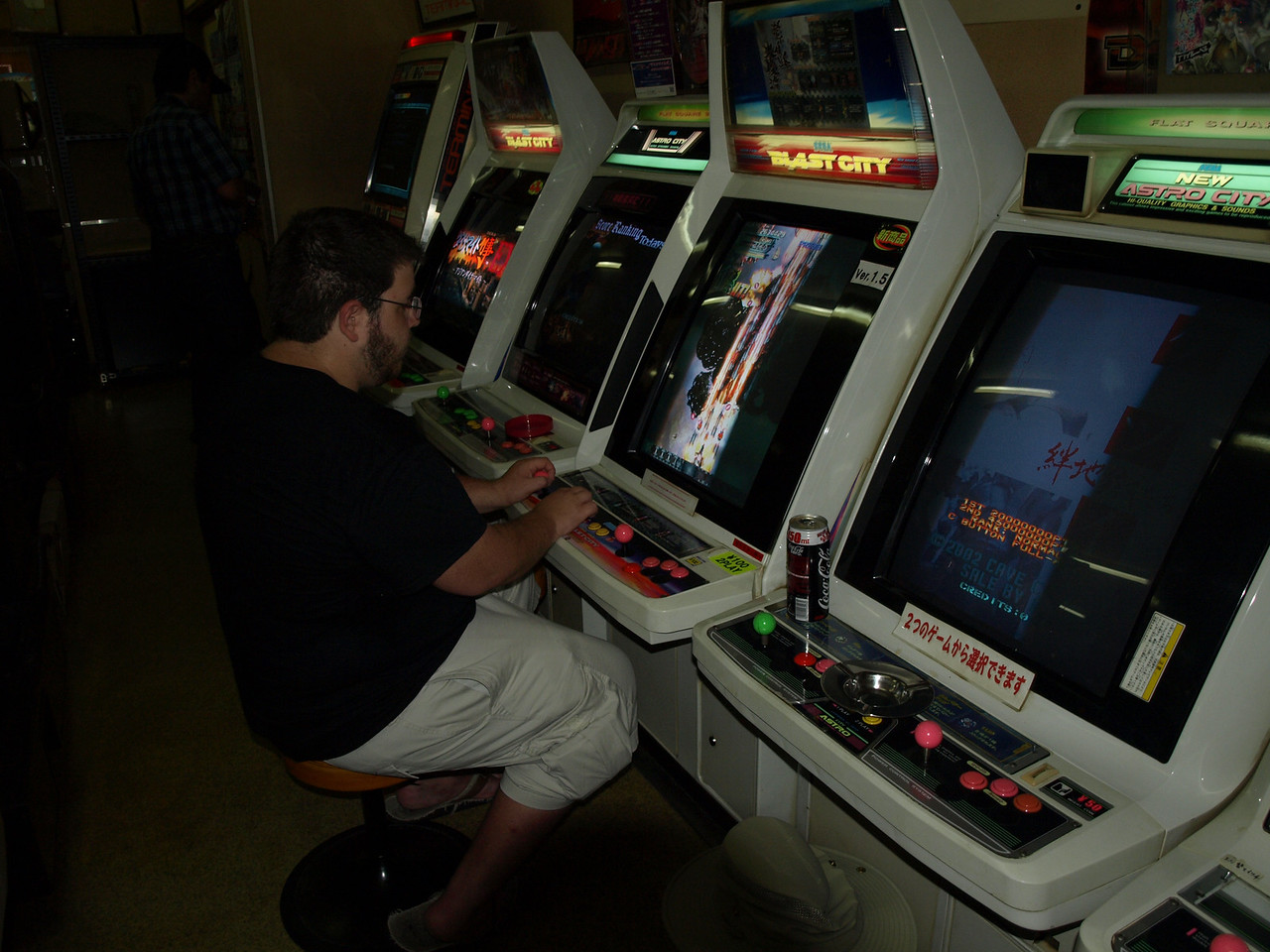 As we continued our little circle around the streets surrounding the hotel, we stopped at a video game room to see what games Japan had to offer. They were surprisingly easy to understand and Josh quickly mastered one of the offerings.