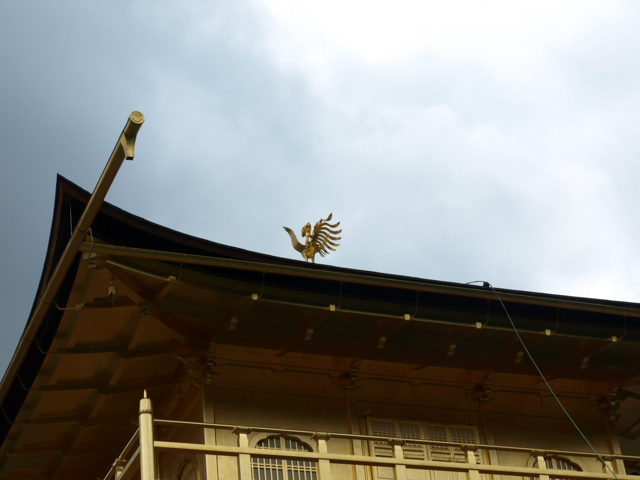At the top of the building is a golden Chinese phoenix