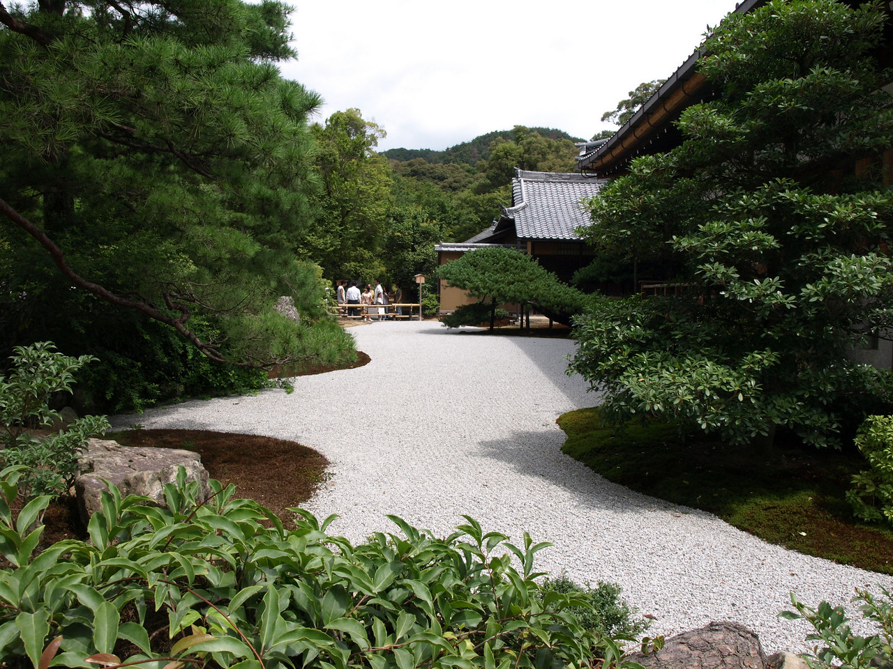 Here is an example of Karesansui, a dry landscape garden. Patterns are raked into the sand which are said to promote peace and harmony in the viewer.