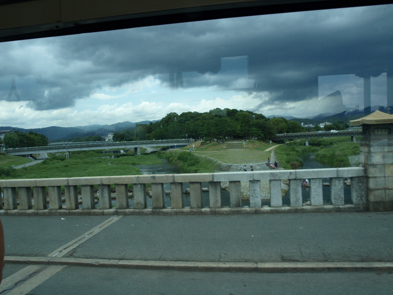 Looking north on the Kamo River. Note that the river splits in two here and, visible through the bridge rails, are large stepping stones that allow pedestrians to cross the river.