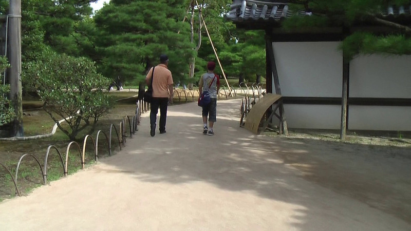 With this video, we take our leave of the gardens and walk through a small gate that leads to the moat surrounding the inner Honmaru Palace.
