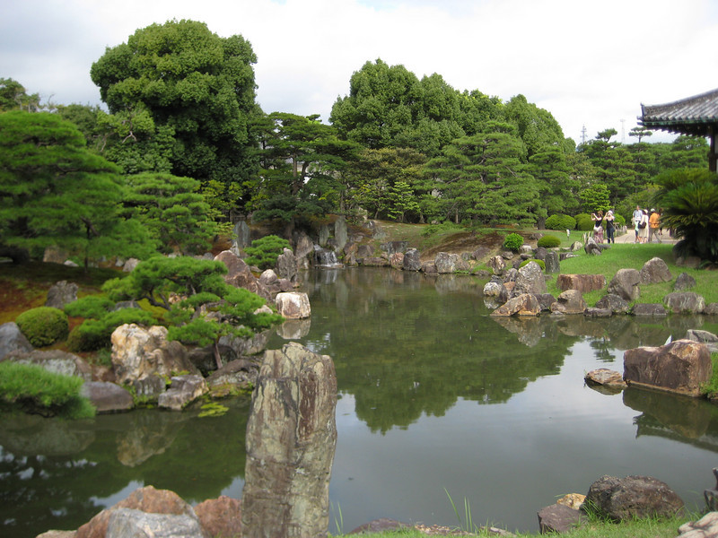 The garden is made up of three carefully placed islands along with many rocks and trees.