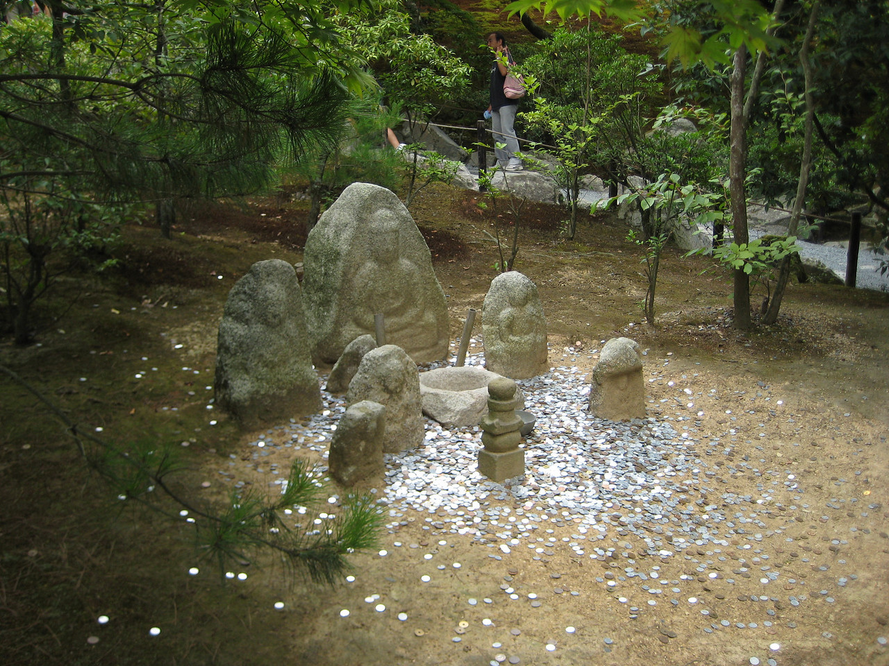 A variation on the wishing well. If you can toss your coin into the stone bowl in the center, your prayer will be answered.