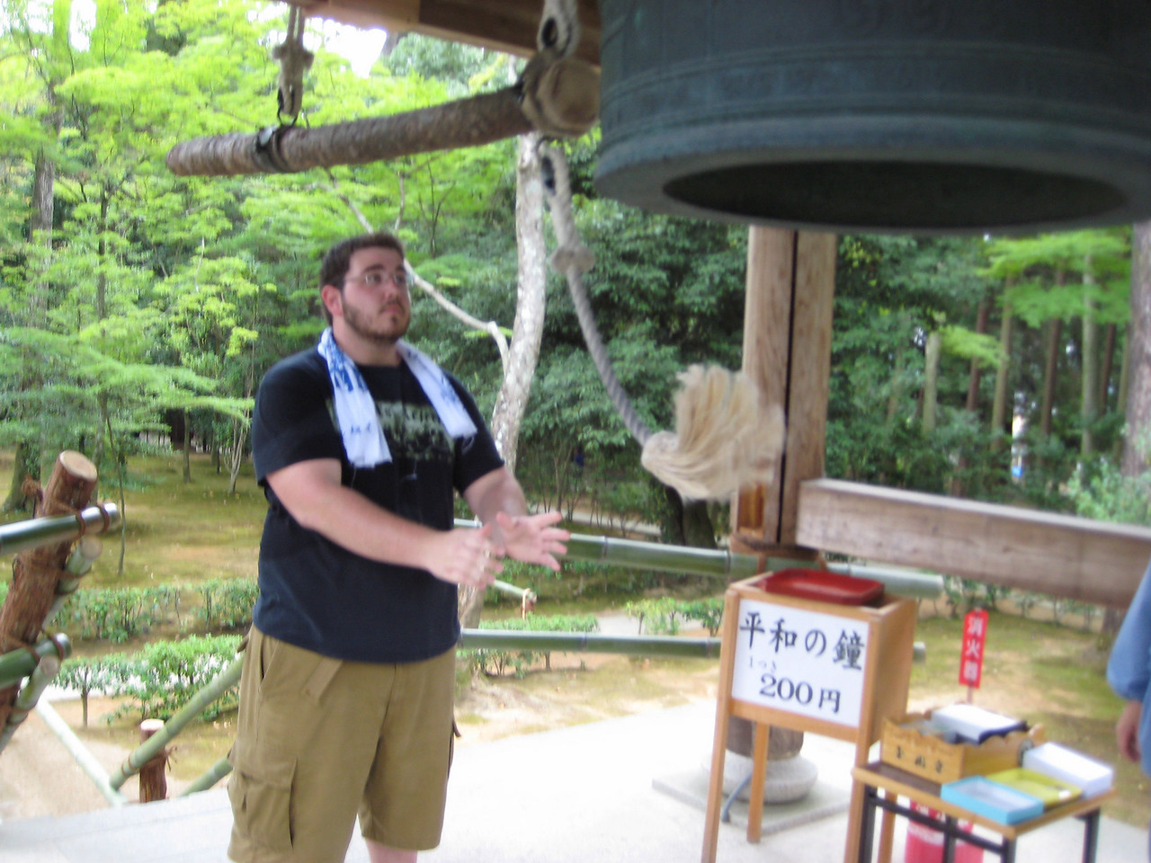 As you can see from the sign, they requested a 200 yen (about 2 dollars) donation to make your prayer. Following the attendant's instructions, Josh swung the rope and then released it just before the shaft struck this 800 year old bell.