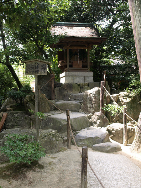 As we walk, we see a small shrine off to one side.