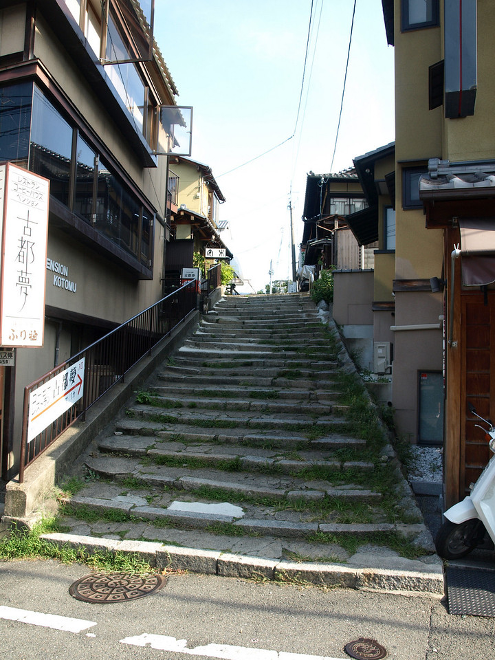 We pass by an ancient staircase detour to the right, as we continue towards the temple
