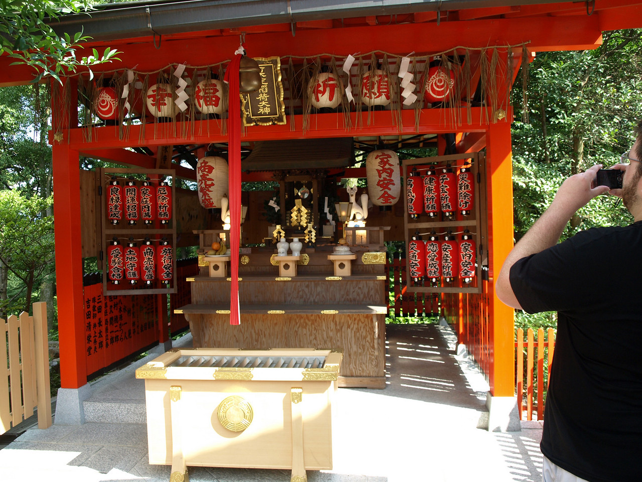Josh taking a photo of this small shrine