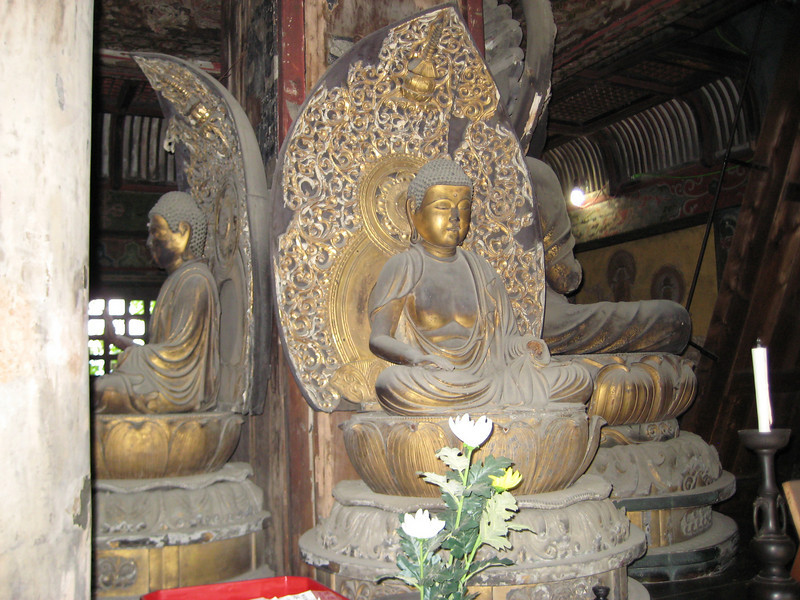 There are actually four Buddha figures in a circle around the center of the pagoda