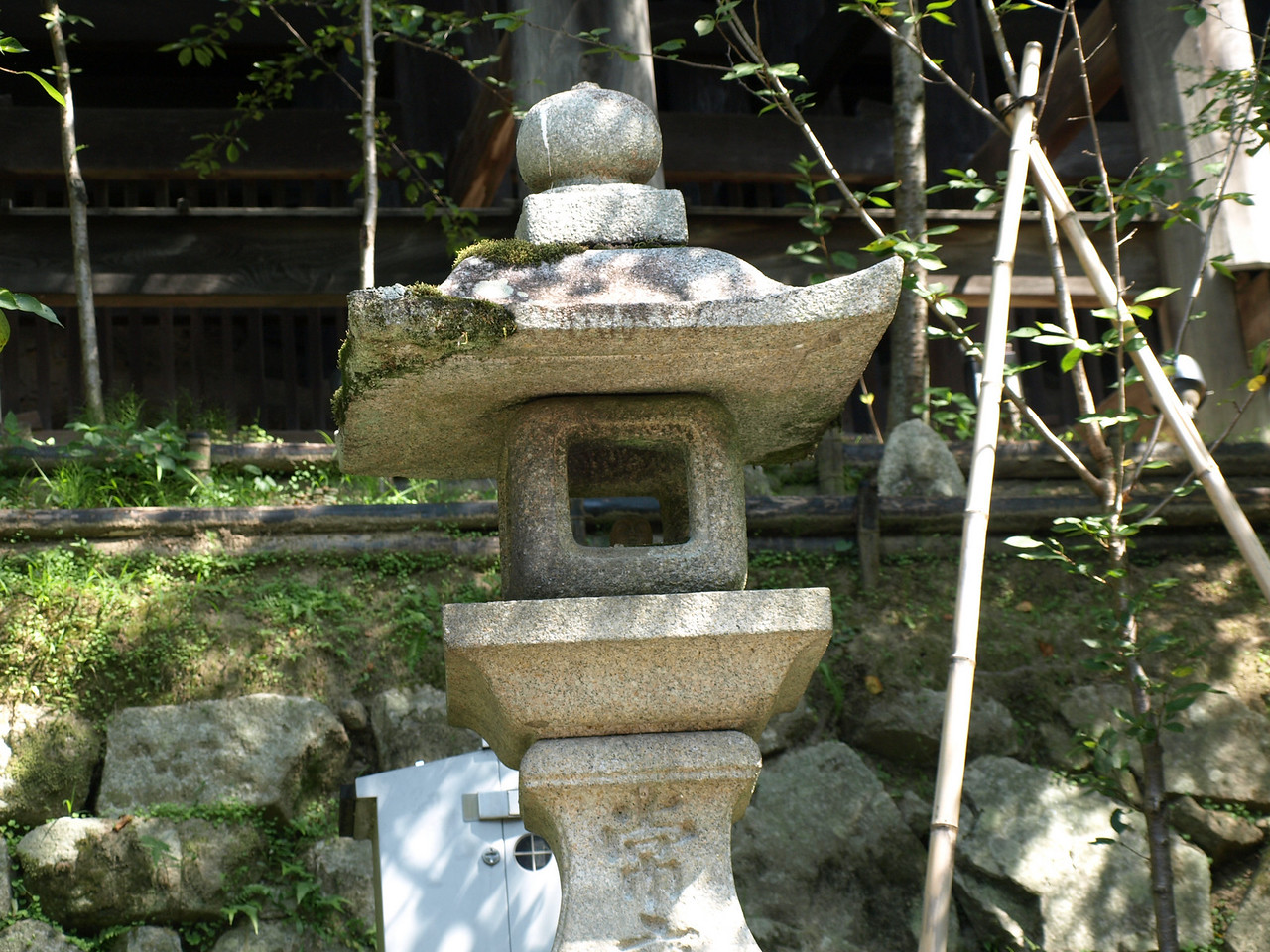 A stone lantern at the foot of the main hall