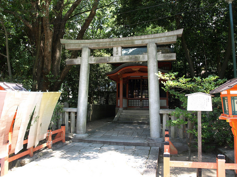 A small altar behind its own torii.