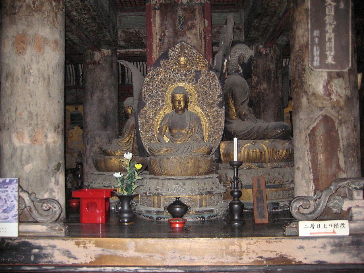 A small Buddha figure to one side of the pagoda