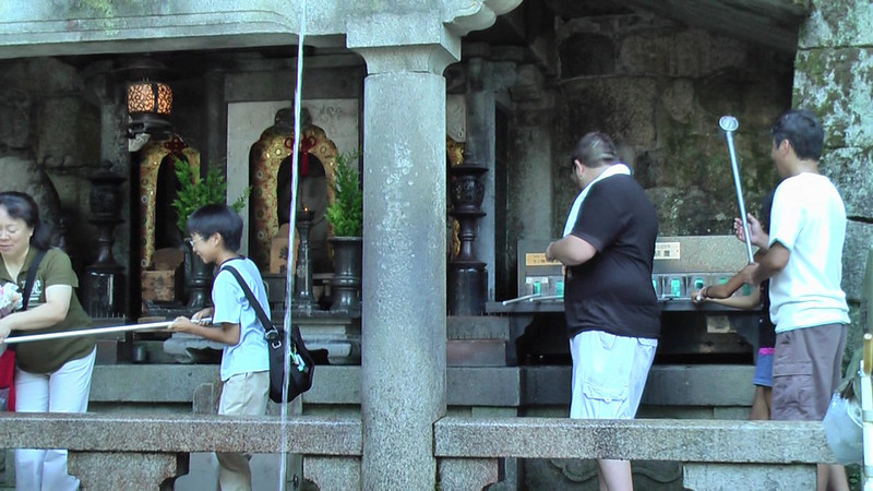 Josh takes a drink from the Otowa-No-Taki waterfall. Note the ultraviolet lamps to sterilize the drinking cups.