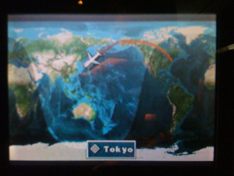 As when Jennifer and I traveled to Japan, the flight path curved up over Alaska and the Bering Strait.<br /> <br /> What you're looking at here is the little monitor mounted in the seatback in front of me. We used these alot during the flight to watch movies and play simple video games.