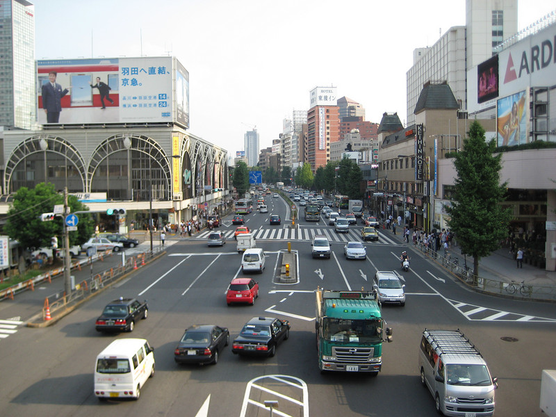We arrived at Shinagawa without incident. It was just after 4 PM, so we were in no hurry as we made our way to the hotel which involved us crossing this busy highway via an overpass. This view is looking to the south. The wheeled cart backpack arrangement worked out fine as we rolled our stuff along with us.