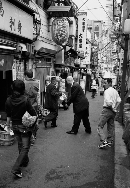 Tokyo, Nishi-Shinjuku<br /> <br /> 'The exchange...'<br /> <br /> May 2008<br /> Tri-X 400, EI 800