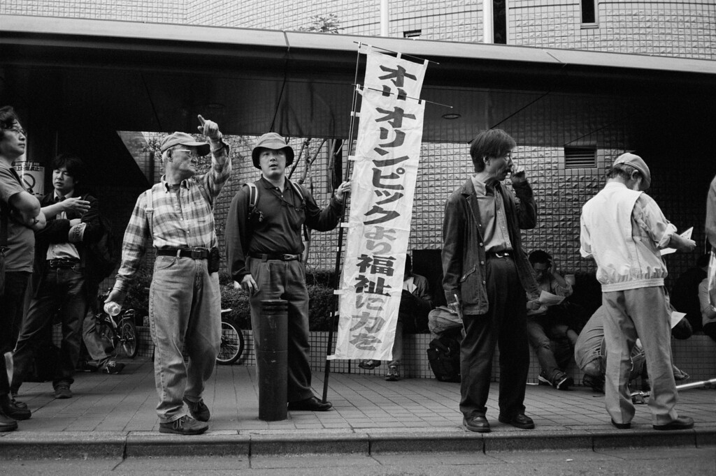 Tokyo, Okubo <br /> <br /> Socialists gathering for a May Day march...actually, it was 3 May. Just a few blocks from my apartment.<br /> <br /> May 2008 <br /> Tri-X 400, EI 800