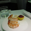 UAL 837 F dinner beginnings: signature jumbo shrimp cocktail with wasabi-infused cocktail sauce.