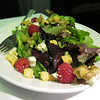 UAL 837 F dinner beginnings: fresh seasonal greens with raspberries, pecans, crumbled feta cheese and seasoned croutons (with Asian sesame ginger vinaigrette).