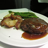 UAL 837 F dinner: grilled fillet mignon with port wine demi-glace, roasted rosemary potatoes, and sauteed asparagus with sun-dried tomato.