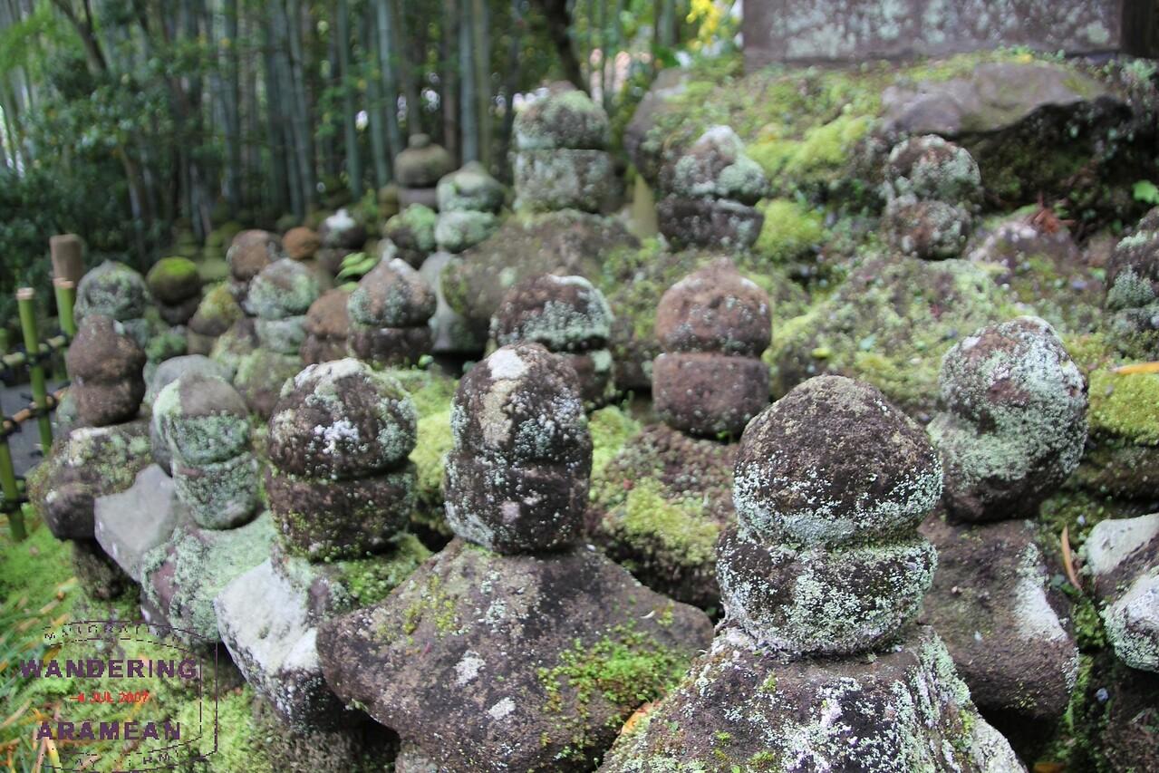 Memorial stones left in honor of fallen warriors at the Kokokuji Temple