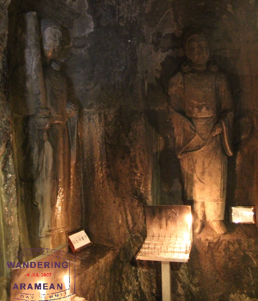 Icons carved into the rock walls of Hahedera's Benten-kutsu Cave
