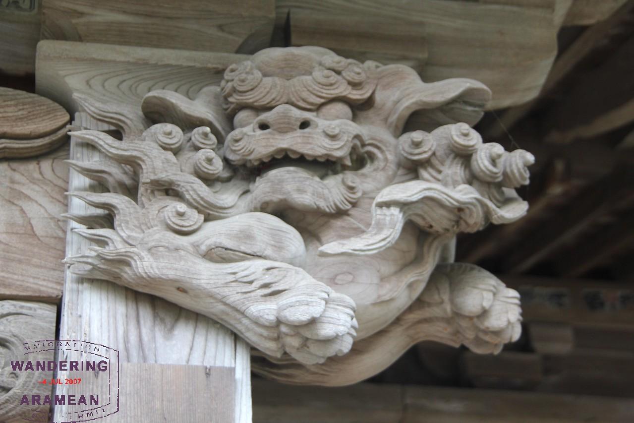 Intricate woodwork detail on this column header