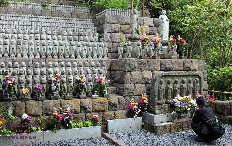 Pausing to pray at Hase-dera