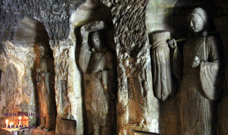 Inside the Benten-kutsu Cave at Hasedera; many icons carved in the rock walls