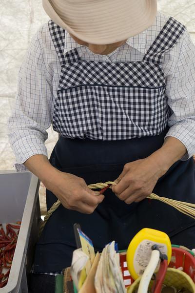 Kanazawa Market. Plaiting Chllies.
