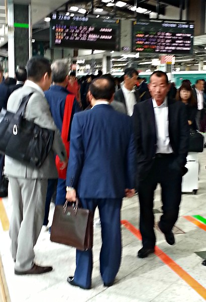 Japanese businessmen also waiting for the train.