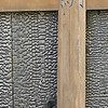Interesting technique to seal the wood cladding on a house exterieur -- a controlled burn, which seals to water, repels insects and is more resistent to fire