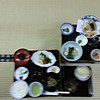 My fuzzy photo of supper. Lots of little items, in different ceramic and procelain dishes, very good, vegetarian.