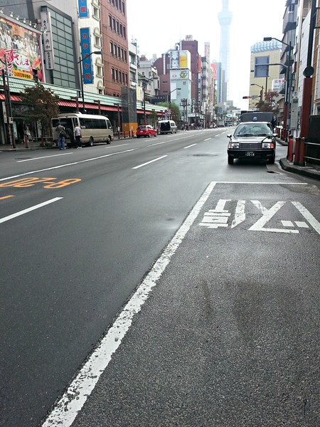 "The street in front of our hotel on a Monday morning around 8h30. We had been told that parking is severely restricted in Tokyo, and that people drive ""zen"" and most peope are on the trains underground. Here we see the result."