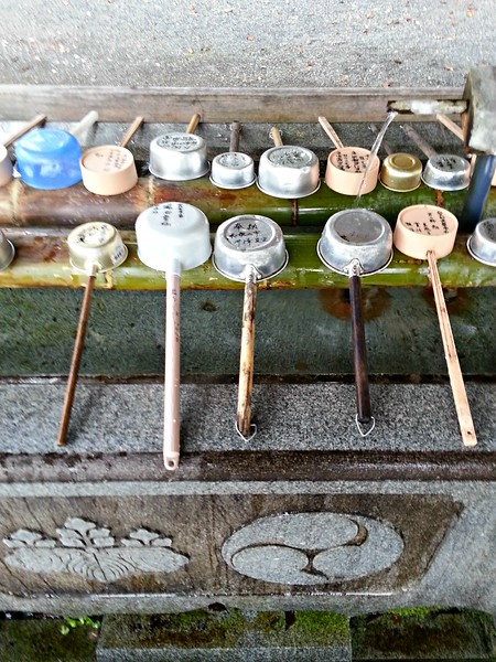 There are often fountains with these ladles, so that people can purify themselves with the water.