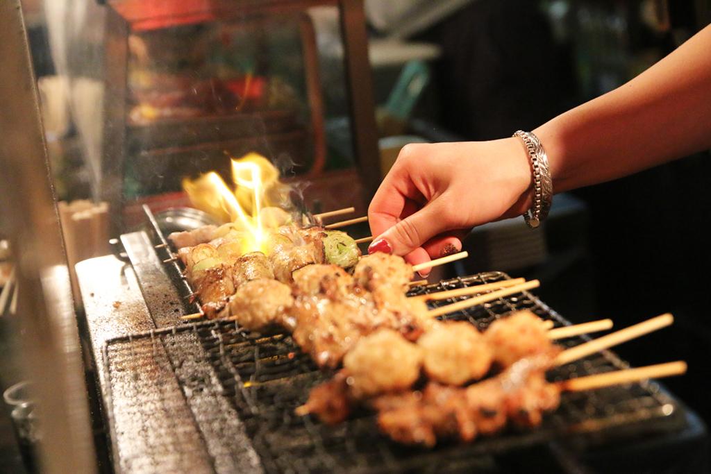 Eating yakitori in Tokyo