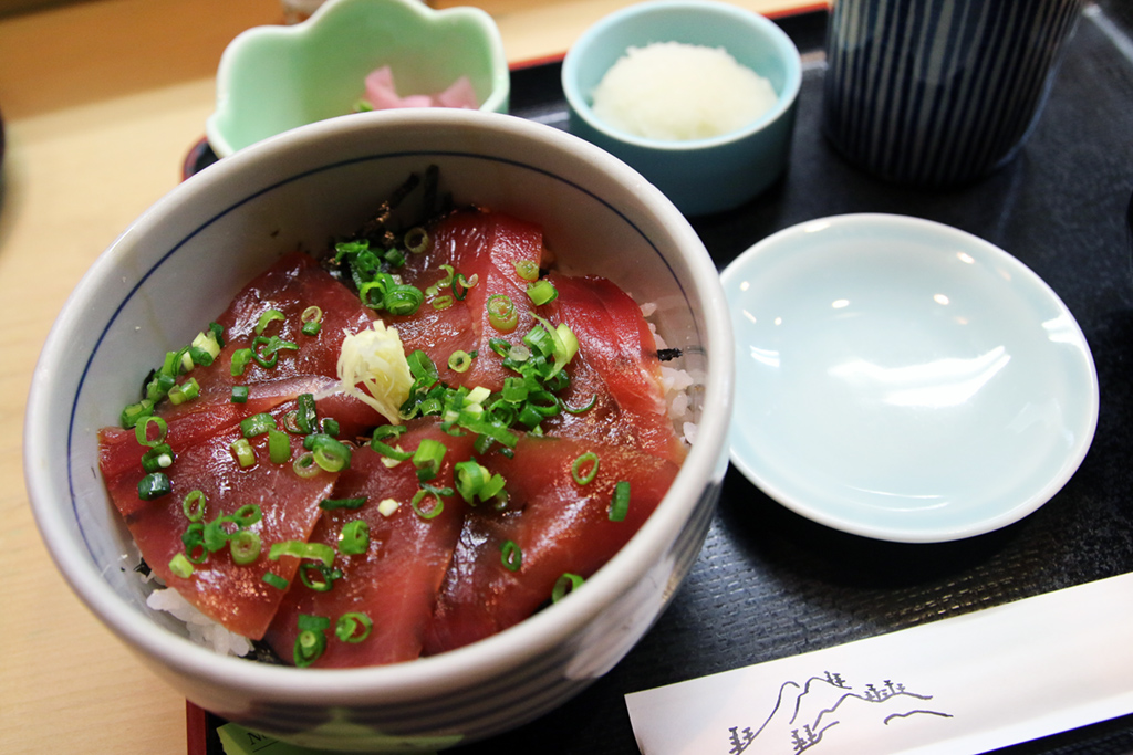 "Deep red colored ""maguro"" tuna, covering rice"