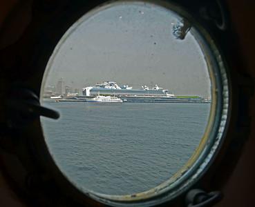 Our Cruise Ship thru a Porthole on the Maru