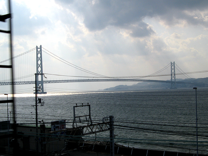 Viewed from the train: the Higashi-Kobe Bridge, with a length of almost four kilometers, is the world's longest suspension bridge